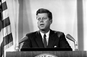 """U.S. President John F. Kennedy reports to the nation on the status of the Cuban crisis from Washington, D.C. on Nov. 2, 1962. He told radio and television listeners that Soviet missile bases """"are being destroyed"""" and that U.S. air surveillance would continue until effective international inspection is arranged. U.S. government conclusions about the missile bases, he said, are based on aerial photographs made Nov. 1. (AP Photo)"""