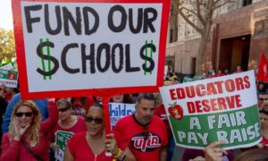Teachers in the nation's second-largest school district will go on strike as soon as Jan. 10 if there's no settlement of its long-running contract dispute, union leaders said Wednesday, Dec. 19. The announcement by United Teachers Los Angeles threatens the first strike against the Los Angeles Unified School District in nearly 30 years and follows about 20 months of negotiations. (AP Photo/Damian Dovarganes) ORG XMIT: CADD303
